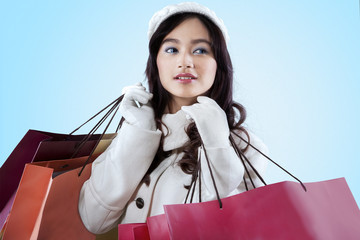 Female in warm clothes with shopping bags