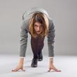 businesswoman standing in start position