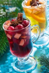 Christmas mulled wine and apple cider on blue background