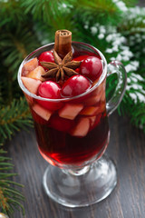 Christmas mulled wine in a glass on a wooden background