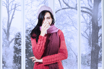 Girl with sweater having flu