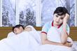 Hispanic woman having insomnia on bed