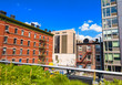 canvas print picture - Highline Park in Manhattan with city skyline on a beautiful day