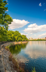 Beautiful colors of Central Park with lake reflections at dusk -