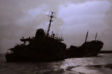 Shipwreck Silhouette Against a Gloomy Sky