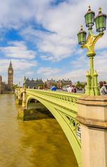 LONDON - SEPTEMBER 29, 2013: Tourists walk on Westminster Bridge