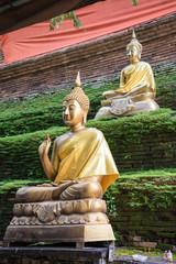 Bronze buddhas at antique pagoda in Chiangmai