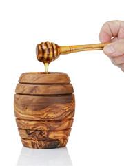 wooden honey pot with dipper