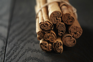 bunch of cinnamon sticks tied with twine