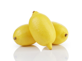 three whole ripe lemons