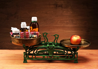 Old kitchen scale, apples and drugs