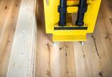 Gluing machine on wooden floor poster