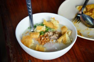 Rice porridge or Congee with white deep-fried doughstick