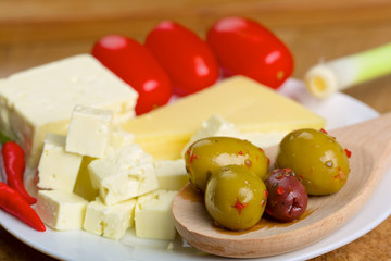 Feta cheese, olives and tomatos on a plate