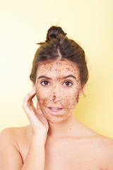 Brunette woman with a scrub applied