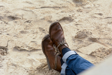 A pair of shoes on the beach