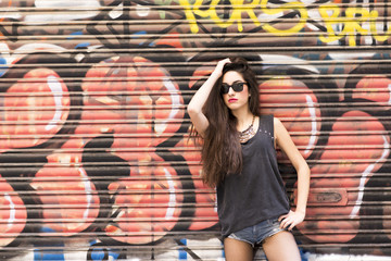 Beautiful woman on urban background, rock lifestyle concept.