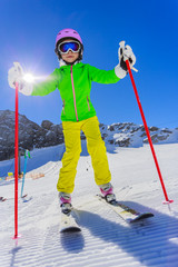 Skiing. Skier girl enjoying winter vacation