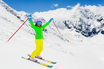 Skiing, freeski - skier girl enjoying ski vacation