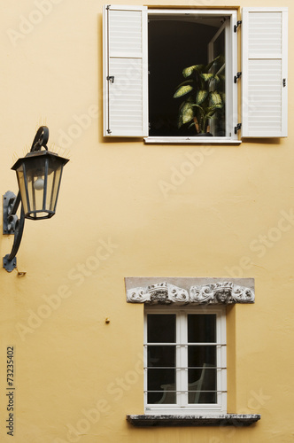 canvas print picture two windows and a lantern