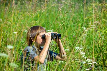 Child looking through binoculars