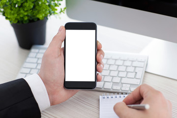 businessman holding phone with isolated screen and writing in no