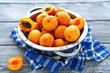 canvas print picture - fresh honey apricots in a colander