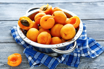 fresh honey apricots in a colander