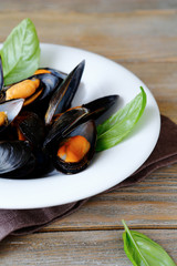 mussels served white plate garnished with fresh basil