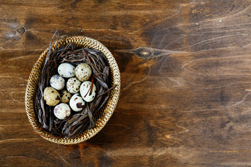 small quail eggs in a basket, top view