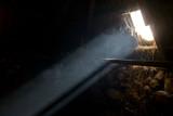 A bright sunbeam enters an old hay barn