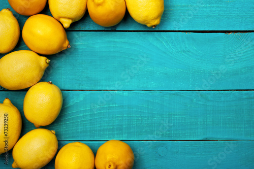Fotobehang Vruchten Lemons on the bright cyan background