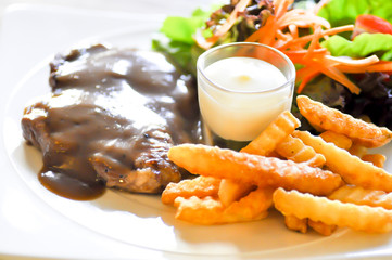 pork steak, French fries  and salad