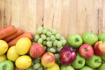 Organic fruits and vegetables mixed on the plank