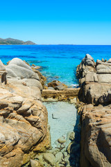 Rocks and azure sea water of Porto Giunco beach, Sardinia island