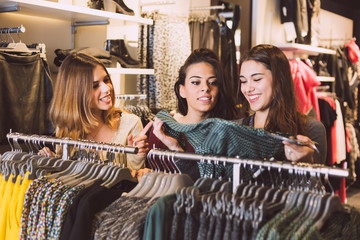 Three Women in a Clothing Store