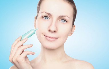Beauty, health skin concept - woman applying cream