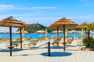 Umbrellas and sunchairs on Porto Giunco beach, Sardinia island