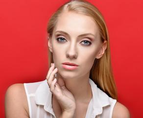 Portrait of the beautiful blonde woman in studio