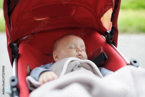 Sweet baby in stroller - 73241666
