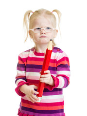 Funny serious kid in eyeglasses with red pencil isolated