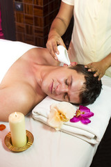 man engaged in Ayurvedic spa treatment © lester120