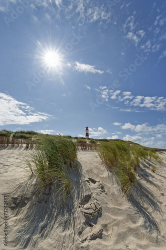 Leinwanddruck Bild Strand mit Leuchtturm am Ellenbogen auf Sylt