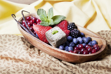 bowl with berries and mint candy