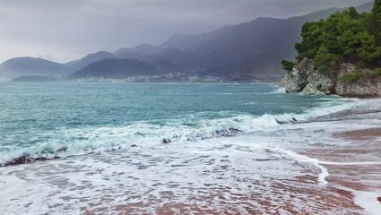 beautiful seascape, sandy beach and mountains