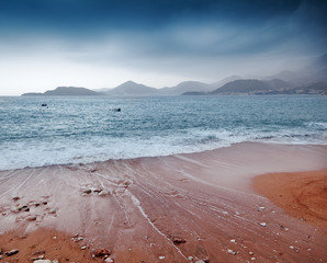 beautiful seascape, sandy beach and mountains