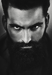 b/w portrait of a brutal bearded man