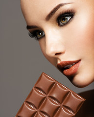 beautiful woman with brown makeup and  chocolate