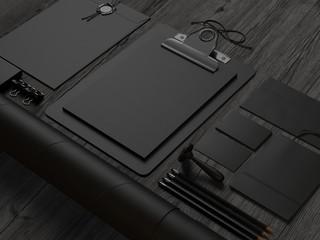 Black  branding elements on black wood background
