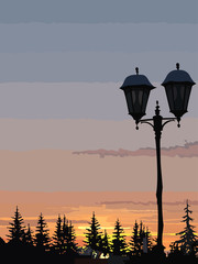 silhouette of street lights and trees at sunset